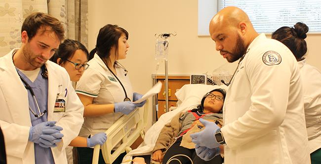 GA-PCOM students diagnose a patient in the simlab