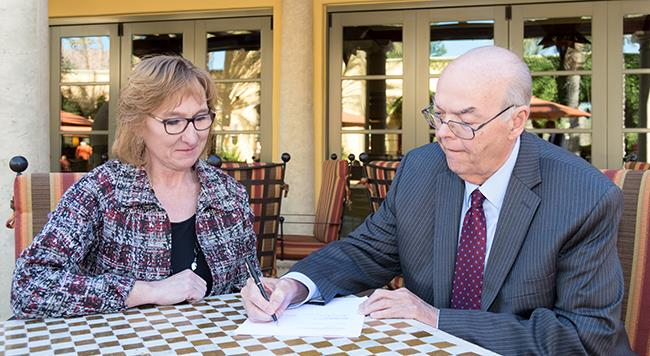 Dr. Shannon signs the MOU