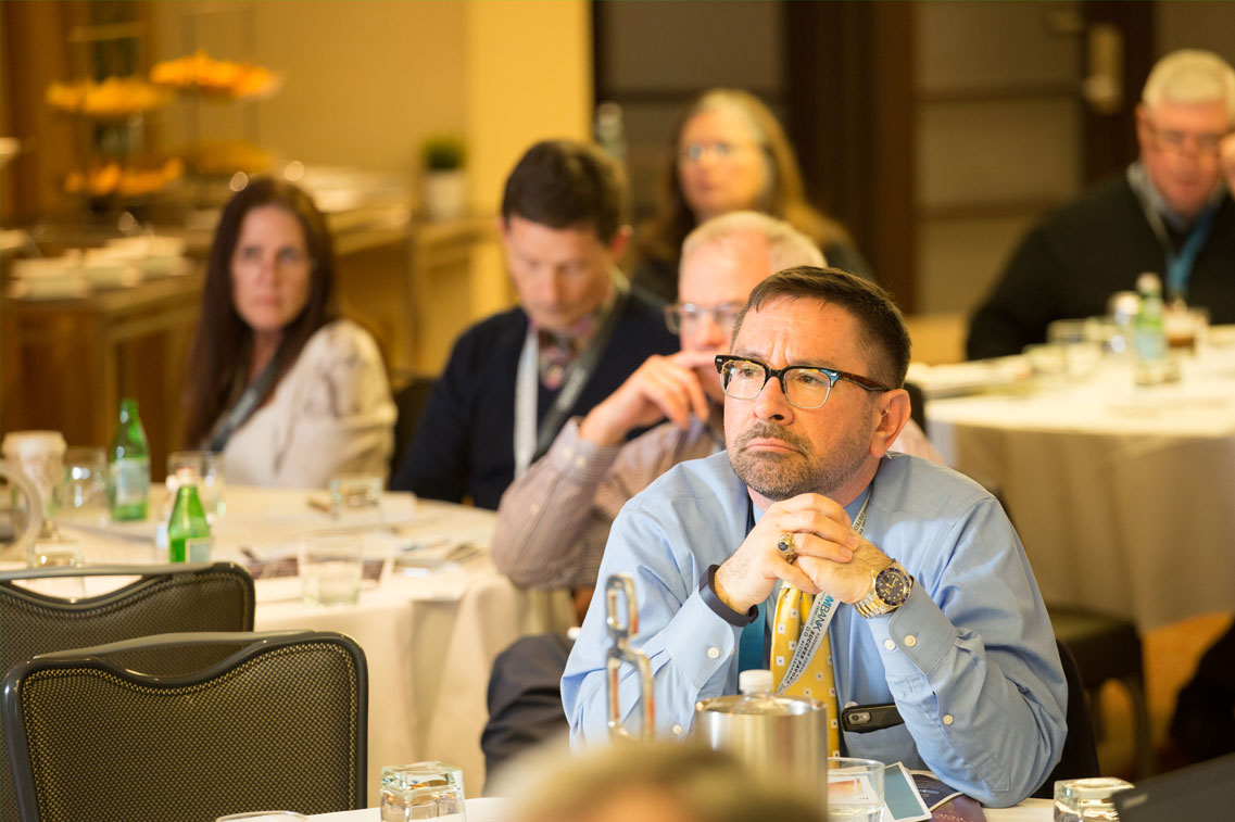 Attendee Listening to Session at Conference