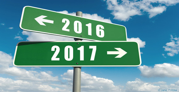 Road signs pointing to 2016 and 2017